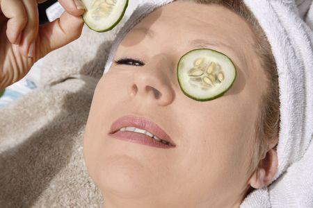 Woman taking care of her face after spa.