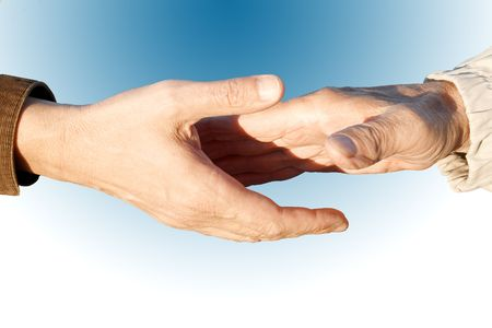 photo of a firm handshake between two adults