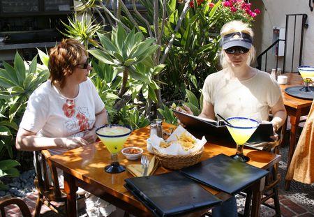 Summer time. Weekend. Women in the restaurant.