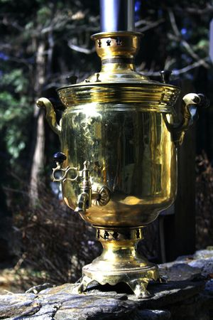antique copper water boiler (samovar)from russia. On the wood fire inside. Stock Photo