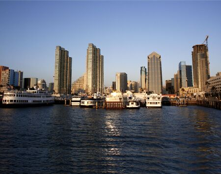 Sunset. San Diego skyline from bay. Boats