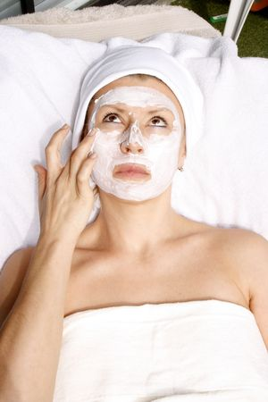 photo of attractive woman with facial mask