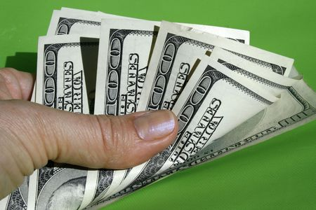 Money in hand on the green background Stock Photo