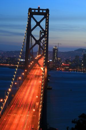 Bay Bridge at sunset in San Francisco,CA, skyline from the Yerba Buena Island. photo