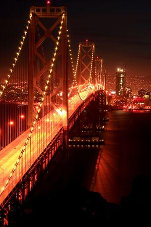 Bay Bridge at sunset in San Francisco,CA, skyline from the Yerba Buena Island.
