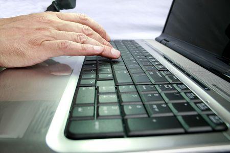 Hand on keyboard Stock Photo
