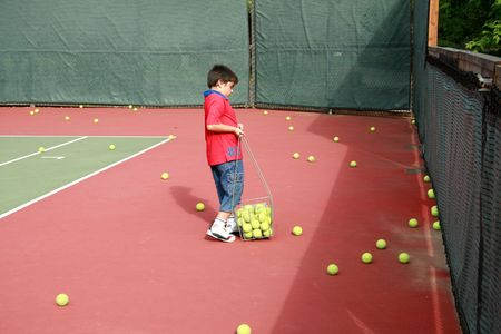 Busy boy on tennis court