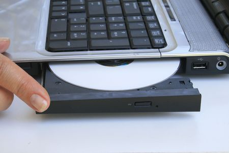Keyboard and finger closing CD Drive