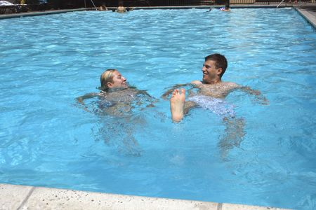 Sunny day. Happy couple in the Pool