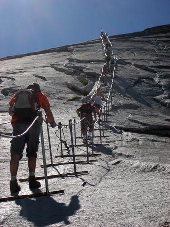 Yosemity, Tourists walking at mountains.