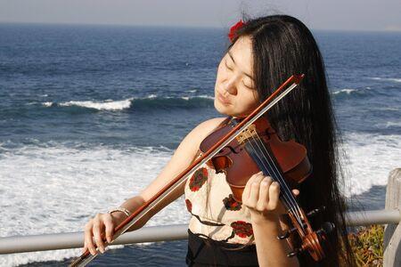 Close up shot of woman playing a violin