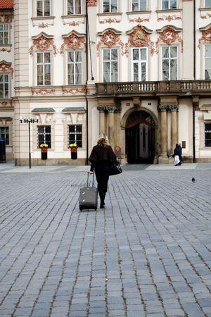 Woman crossing the street in Praga