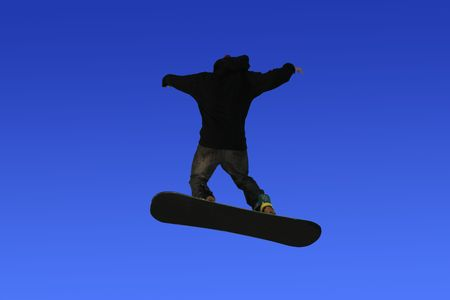 Snowboarder jumping high in the air, skiing photo