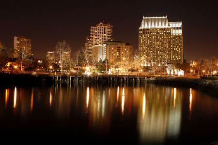 reflecting: Night. Downtown, San Diego, CA skyline.