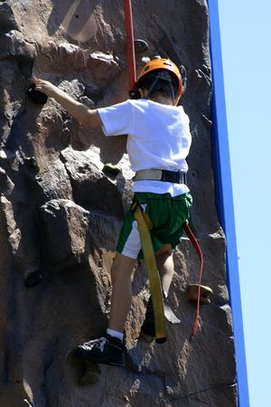 Boy on climbing wall in the park