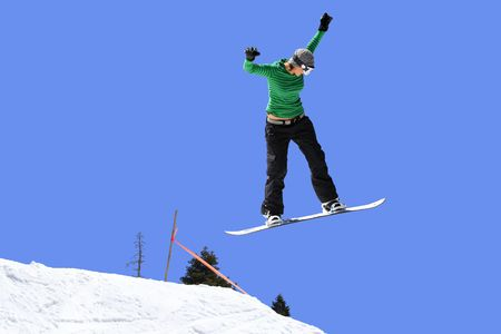 Snowboarder girl jumping high in the air Stock Photo