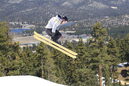 Male skier in the air while in motion on a hill.  Taken at Big Bear Mountains Stock Photo