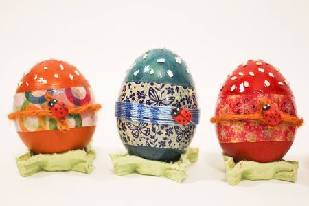 Colorful Easter eggs on a white background, orange, blue, red