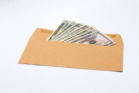 Dollars banknotes in a paper envelope