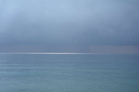 A glimpse of the sun on the sea surface after a thunderstorm