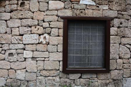 lattice window: Modern window with a lattice in the old town Stock Photo