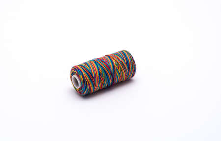 coil of colored thread for needlework Фото со стока