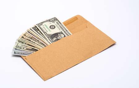 A few US dollar bills in a paper envelope Stock Photo