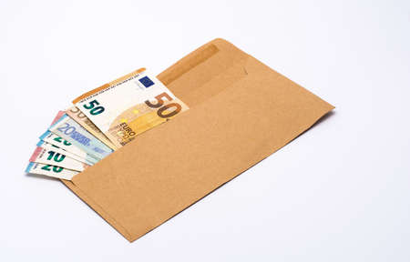 Several euro banknotes in a paper envelope Stock Photo