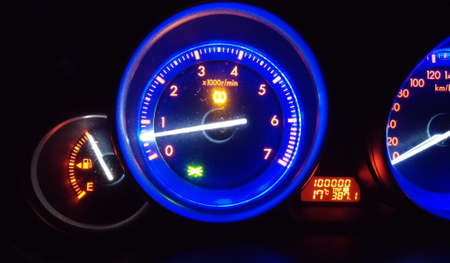 car dashboard with tachometer at night Stock Photo
