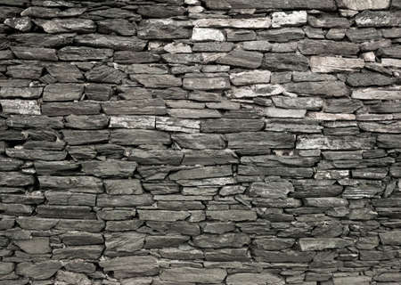 b/w fragment of the old stone wall of the fortress of Constantinople Stock Photo