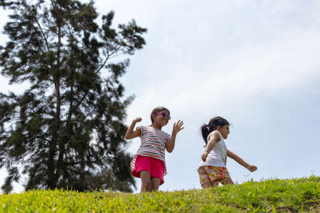 Cheerful girls playing together in the park