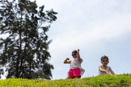 Cheerful girls, playing together in the park