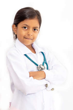 Cute little girl, playing doctor, posing with white coat