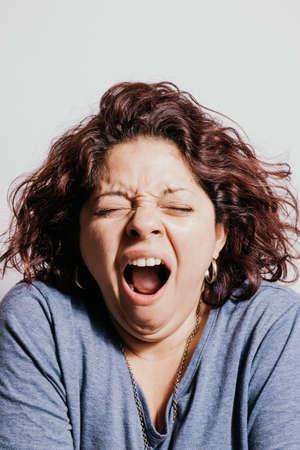 Beautiful redhead woman yawning Imagens