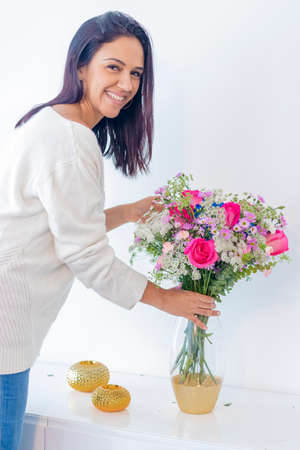 Cute brunette woman enjoying her bouquet of flowers