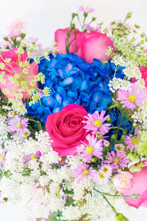 Floral arrangement with roses, carnations, blue hydrangea, snowflake, roses, carnations, blue hydrangea, snowflake