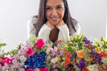 Cute brunette woman enjoying her bouquet of flowers