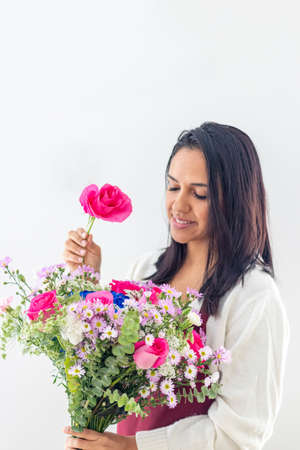 Brunette woman making bouquets at the florist shop Stock Photo