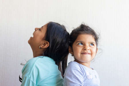 Two little girls looking at each other Archivio Fotografico