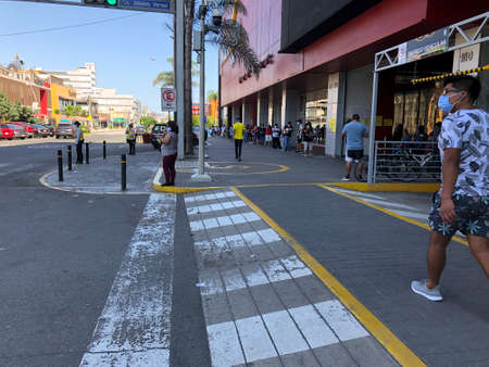 LIMA, PERU - JUL 20TH 2020: People respecting the physical and social distance in the quarantine carried out in the city of Lima, Peru