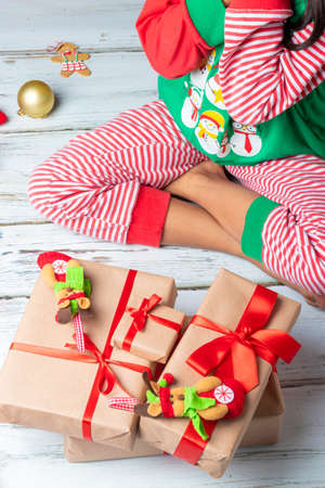 Cute little girl is playing with Santa's cookies and milk at Christmas Stockfoto - 155271232