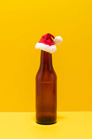 Beer bottle with christmas hat depicted the holidays