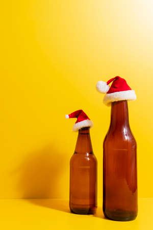 Beer bottles with christmas hat depicted the holidays