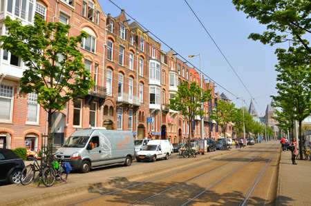 Beautiful street with cars and bikes in Amsterdam, Holland (Netherlands) Stock Photo - 13225942