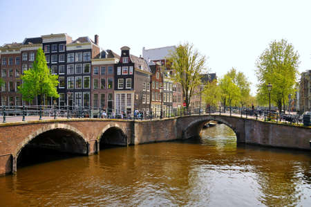 canal house: Beautiful river with 2 bridges in Amsterdam, Holland (Netherlands)