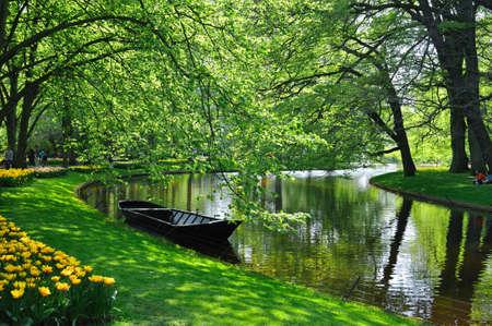 Boat near the river in Keukenhof park in Holland