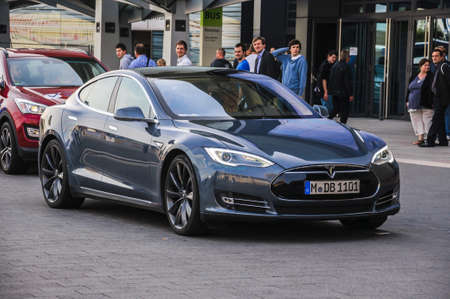 FRANKFURT - SEPT 21: new 2014 Tesla Model S eletric auto presented as world premiere at the 65th IAA (Internationale Automobil Ausstellung) on September 21, 2013 in Frankfurt, Germany