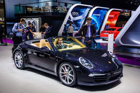 30 s: MOSCOW, RUSSIA - AUG 2012: PORSCHE 911 CARRERA S CABRIO 991 presented as world premiere at the 16th MIAS Moscow International Automobile Salon on August 30, 2012 in Moscow, Russia Editorial