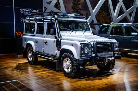 off road racing: MOSCOW, RUSSIA - AUG 2012: LAND ROVER DEFENDER 110 presented as world premiere at the 16th MIAS Moscow International Automobile Salon on August 30, 2012 in Moscow, Russia