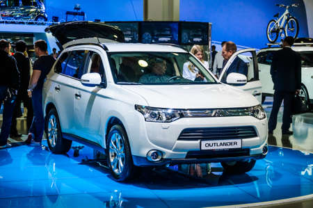 off road racing: MOSCOW, RUSSIA - AUG 2012: MITSUBISHI OUTLANDER 3RD GENERATION presented as world premiere at the 16th MIAS Moscow International Automobile Salon on August 30, 2012 in Moscow, Russia
